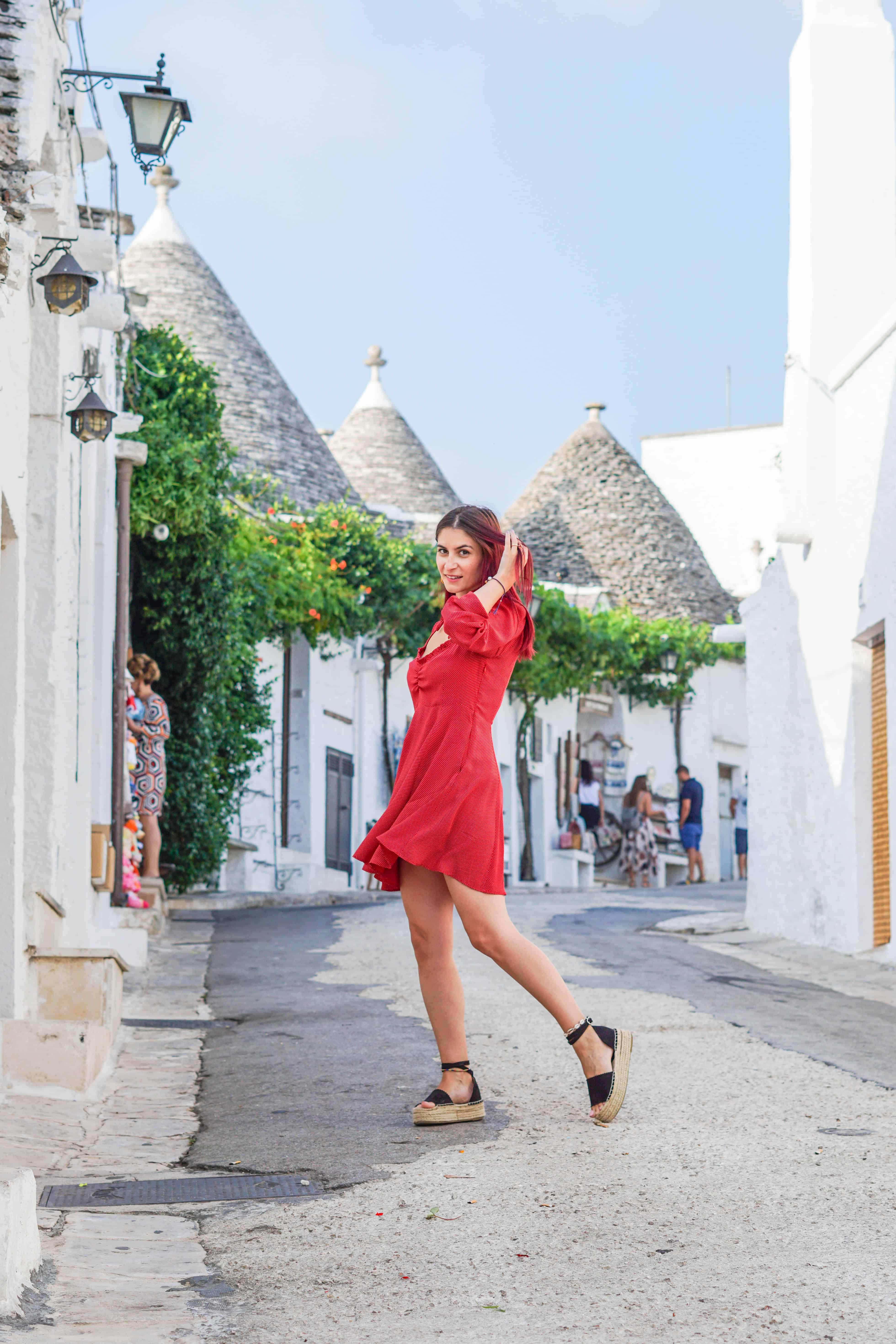 Hidden places in Italy: 4 days in Puglia. Discover one of the most beautiful places in Italy and embark on an Italy vacation you will never forget, without your usual tourist crowds. Read why you should put Puglia on your Italy travel destinations list, and read your perfect Puglia Italy itinerary. Cute outfits for Summer & Italy travel outfits#puglia #italy #travel #itinerary